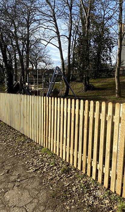 1.2m high wooden palisade fencing on galvanised metal posts